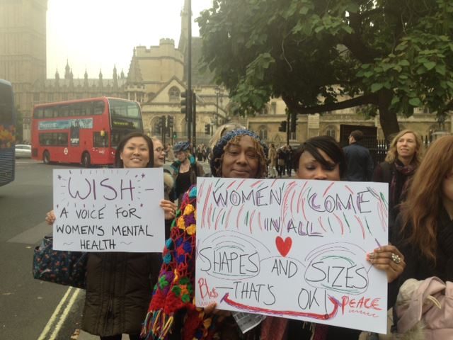 Women campaigning for better mental health at a vigil in London